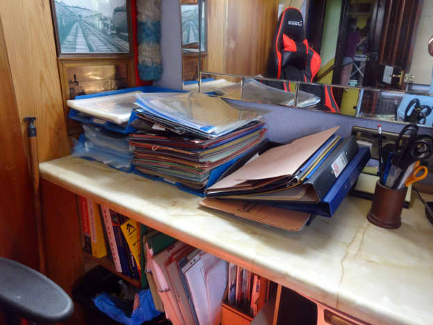 The old plastic filing trays on the side desk to be replaced.