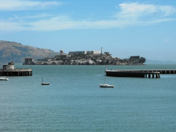 The opening of the circular port with Alcatraz Island beyond.