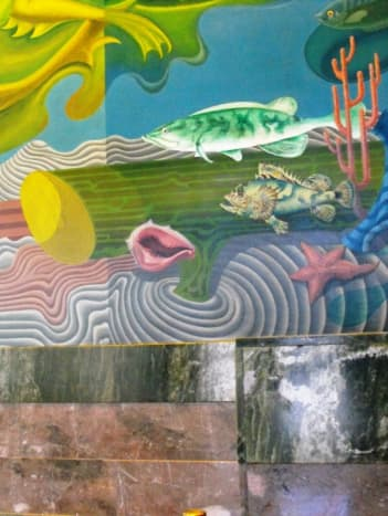 The lobby of the bath house is painted with WPA murals of the oceanic variety.