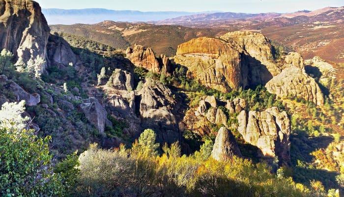 Rugged cliffs at Pinnacles National Park with San Benito Valley in the far horizon