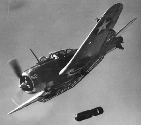 A U.S. Navy Douglas SBD Dauntless dropping a bomb in 1942 at the time of Midway. The Douglas SBD Dauntless was capable of carrying a 1000lb bomb which would prove devastating to Japanese carriers at Midway.