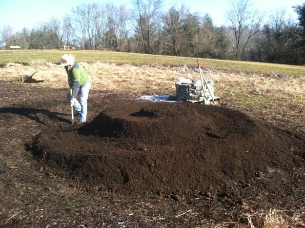 Shape your soil and compost mixture into a raised spiral.