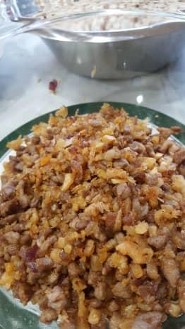Mixture of fried pork, tai tow choi etc.
