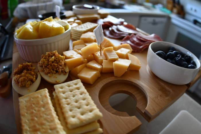 A cheese tasting party should include other treats to help cleanse the palette.