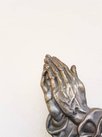 Praying hand statue