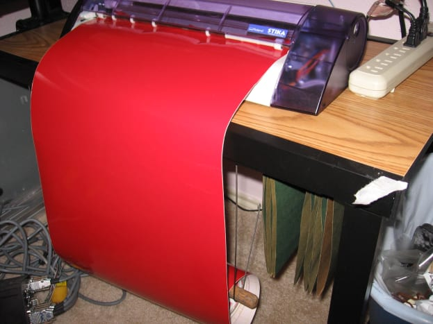 Roland SX-15 Vinyl cutter. I'm using a toilet plunger handle and two coat hanger wires for the roll holder