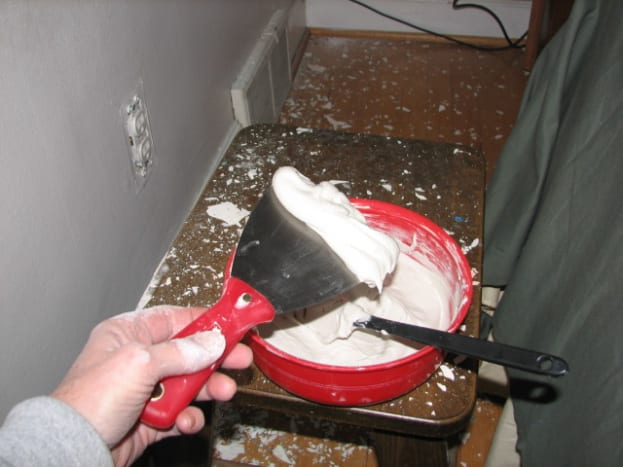 Load the mud knife with a glob and start to fill in the area to repair
