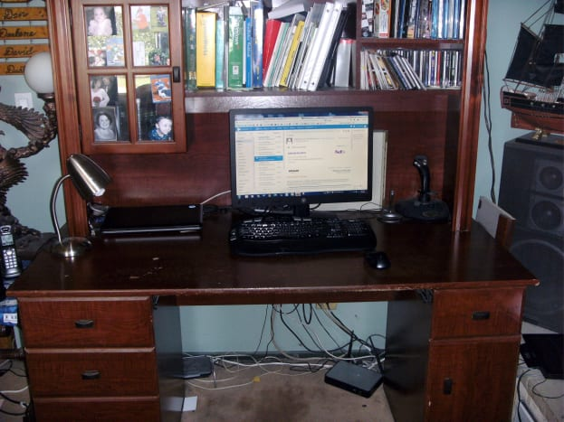The desk, prior to refinishing.  The included shelving above was one reason to keep it, but did need removed.