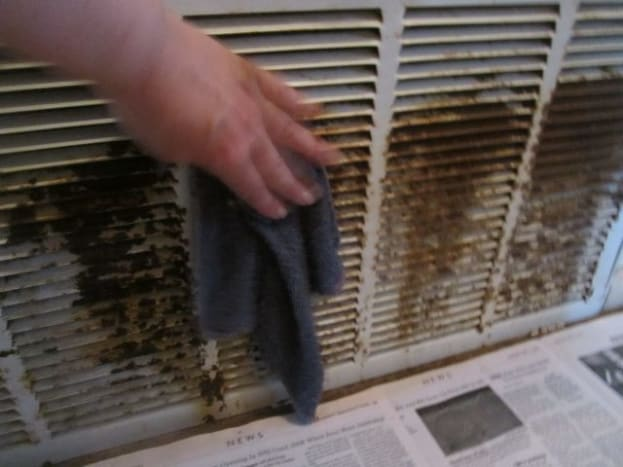 After sanding down the rust, clean vents with damp cloth.