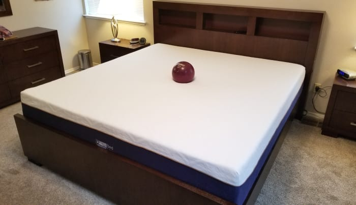 Here's the bed after it sat long enough to become fully expanded, along with my bowling ball in the middle!