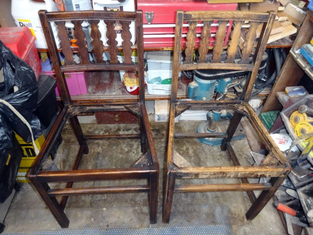 Chairs after being cleaned with the pressure washer:  Left, re-stained with wood dye, and right, chair waiting to be re-stained.