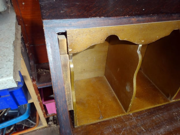 Unsightly gap at each end of the pigeon-holes where the decorative trim doesn't go the full width of the bureau (in image, pigeon-holes unscrewed from desk and pulled forward).