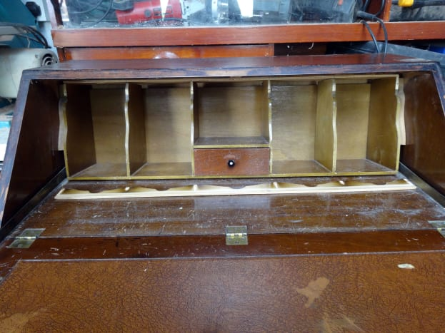 Decorative trim removed from the pigeon-holes to reveal gap between top of pigeon-holes and the top of desk.