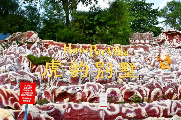 The gaudy main sign at the entrance to Haw Par Villa offers a hint of the macabre attractions found within the statue park.