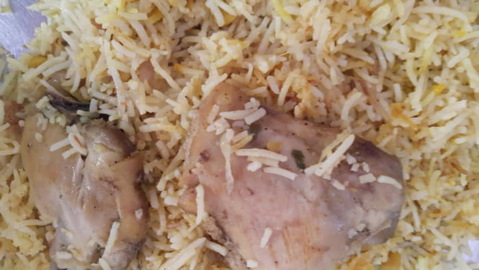 Machboos is the rice part which is cooked in saffron, to add a rich, unique flavor to it. Split chick peas and raisins are also added for flavor and texture. The rice is then topped with cooked chicken or lamb pieces.