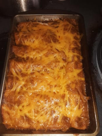 Carnitas and cheese enchiladas