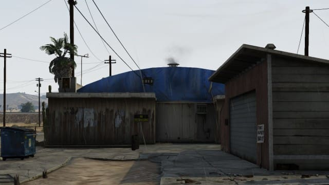 This is the building you want to run to at the beginning of the match. It's at the end of the street on the right.