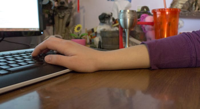 Keep forearms and wrist flat while typing.