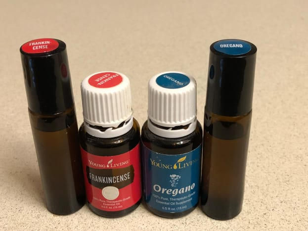 Frankincense and oregano oil, and rollerball bottles