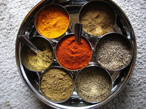 Spices, including cumin, cayenne, tumeric, and corriander.