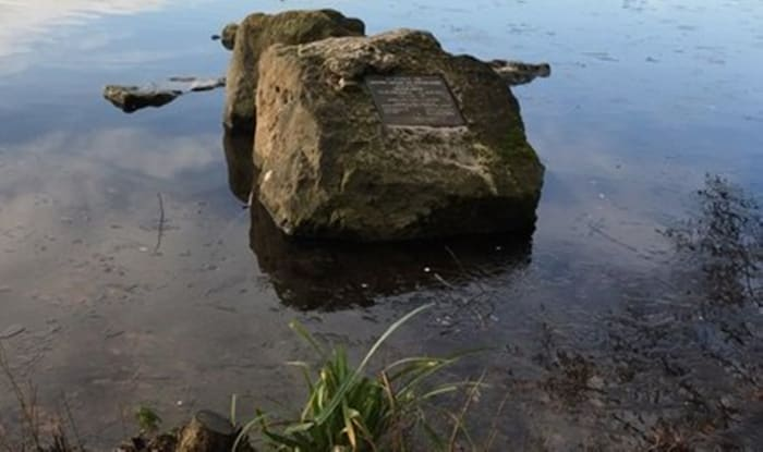 This rock stands  a few feet from the water's edge and is within sight of the visitor centre. The plaque commemorates the official opening of Westport Lake by Ted Heath in 1971