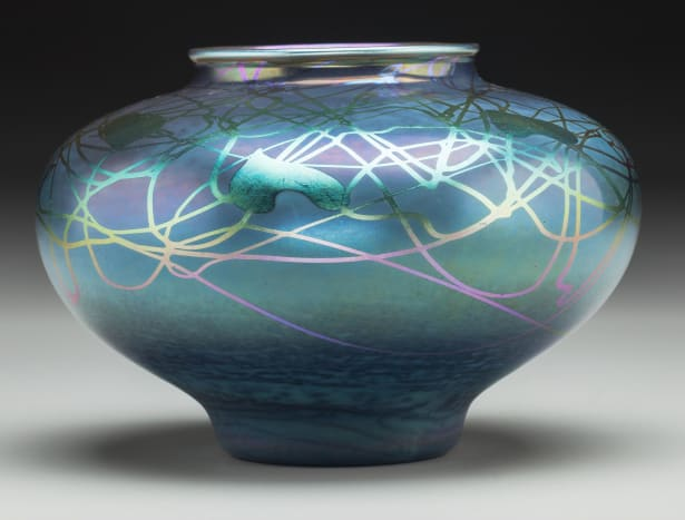 Between 1903 and 1932, Steuben produced colored glass, such as this iridescent Tyrian bowl from 1916.