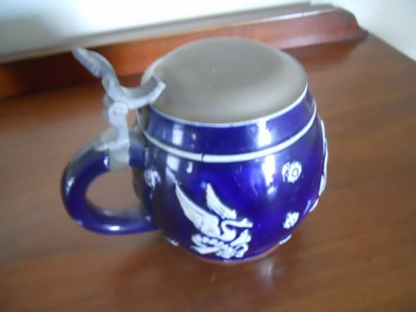 Very pretty beer stein. We have owned it in our family since at least 1970.