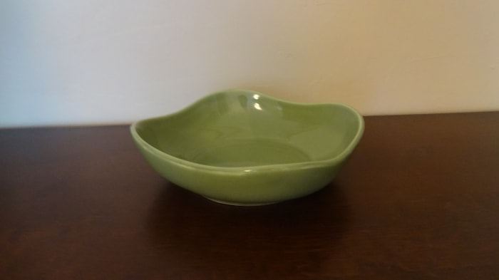 This is a Hall China candy dish.