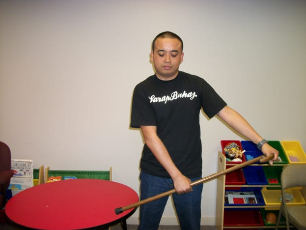 Use a cane to move the affected arm. With your unaffected arm, move your affected arm to the side.