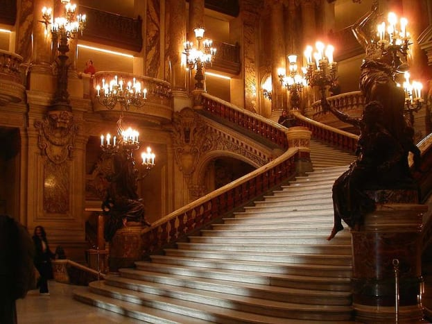 The Palais Garnier Opera house, truly exist in France. In the novel Phantom of The Opera, it is the location of a mysterious opera ghost, and the place a Phantom travels unseen through trapdoors.