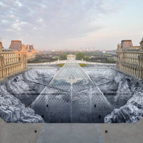 The Louvre's paper art installation was created by modern artist JR on the occasion of 30th anniversary of the Louvre Pyramid. This artwork has been praised for its brilliant optical illusion effect.