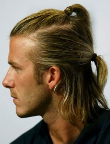 Double-ponytail on a man.