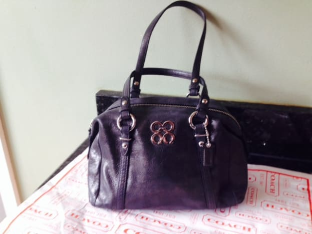Coach Juliete Mini Satchel Bag. Front view. Although the creed is actually inside this purse, many of these small purses do not have them. Some other ways to verify besides the sales tag would be by the hang tags or any hardware on the purse.