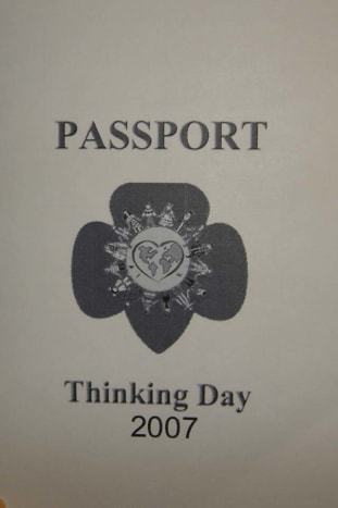 A simple passport, printed on 8x5 x 11 plain paper, folded in half. Inside, a grid for passport stamps.
