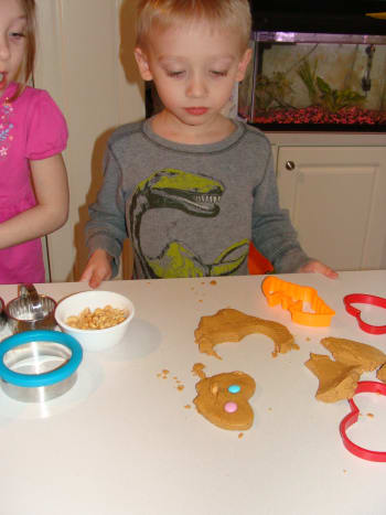Yummy fun with cutting shapes out of the edible playdough.