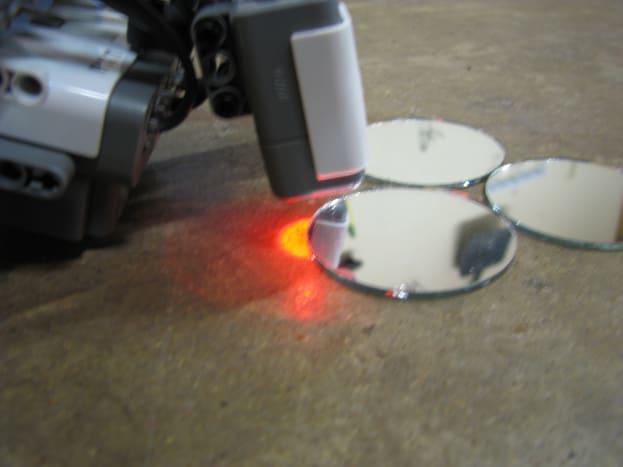 Lego robot using light sensor to find mirrors.