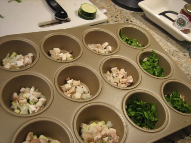 Fill the cupcake pan with chopped veggies