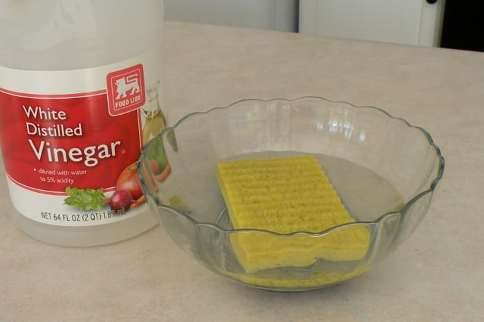 Wet sponge with water and a splash of vinegar before placing in the microwave.