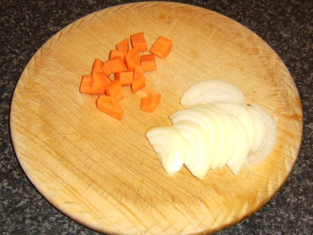 Carrot is diced and onion finely sliced.