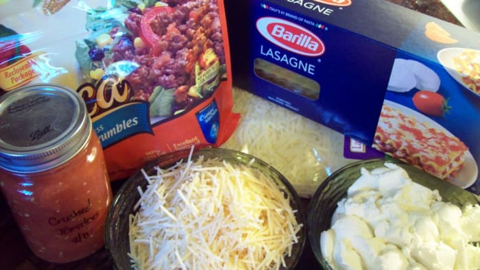 Gather your ingredients for veggie crumble lasagne.  Here I used Parmesan, mozzarella, Boca veggie crumbles, ricotta cheese, and lasagne noodles.
