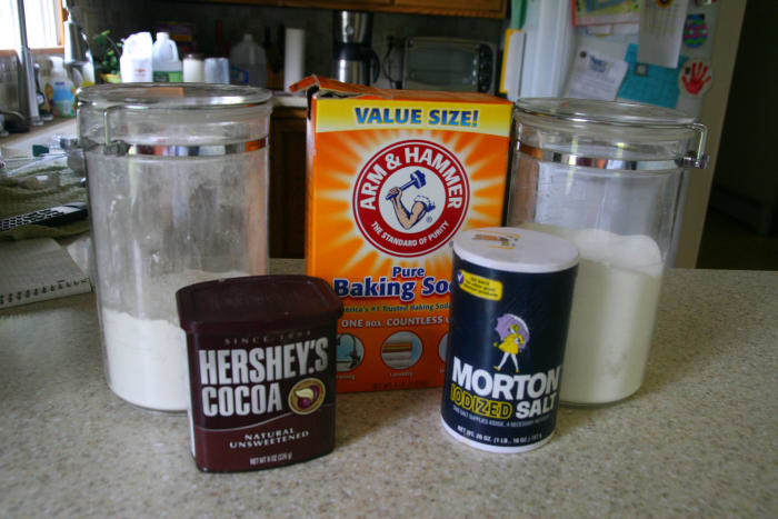 The dry ingredients for Wacky Cake: flour, baking soda, cocoa powder, and sugar.