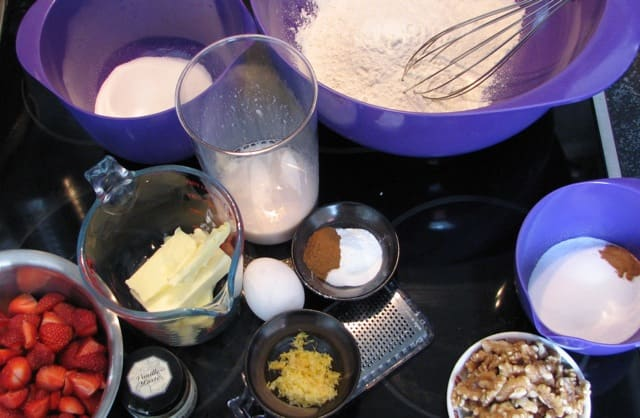 Ingredients for strawberry muffins and crunchy walnut topping.