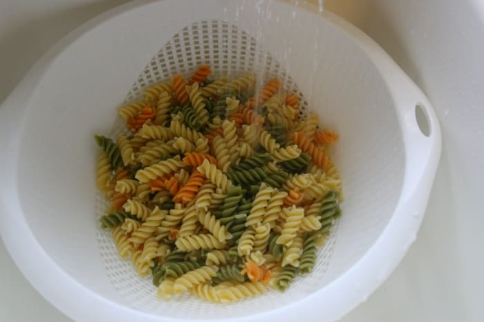 Cook and drain the pasta. Rinse under cold water.