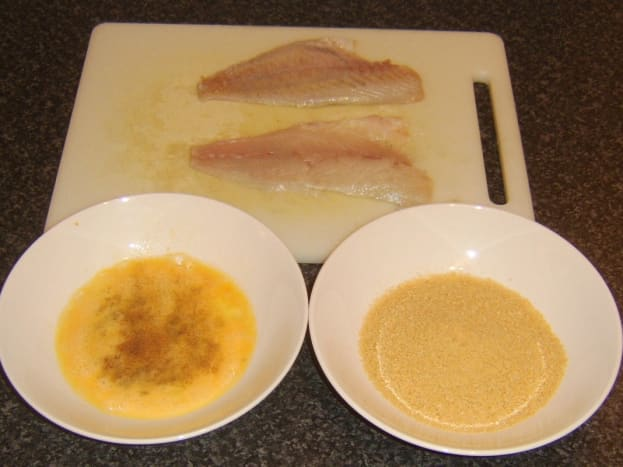 Preparing sea bream fillets for pan frying in breadcrumbs