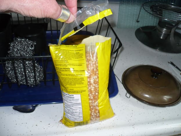 Cut the entire top off the bag of popcorn