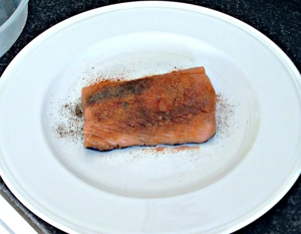 Salmon is spiced before being left to marinate