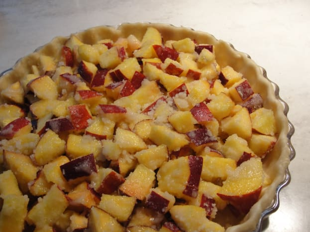 diced peaches mixed with flour and sugar