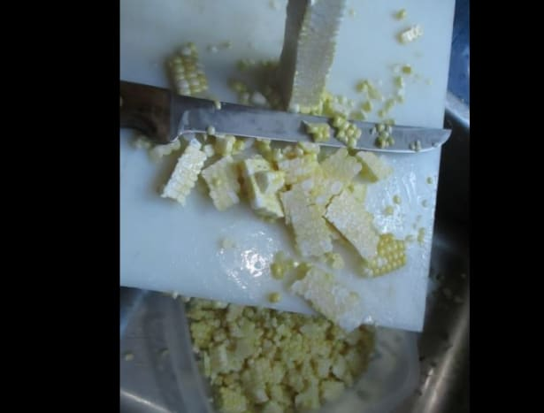 Using sharp knife, slice the kernels off the cob