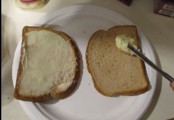 Spread the frosting on the bread.