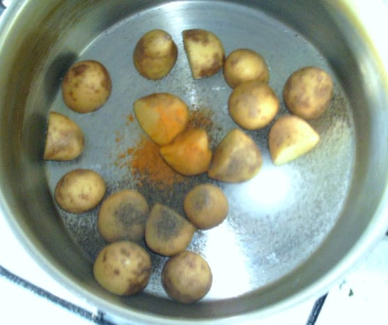 Potatoes are seasoned prior to being boiled.